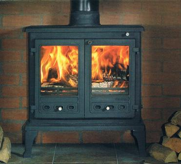 stove with ornate timber fireplace surround engineered wood flooring